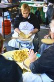 Farmers making talos in fair of Santo Tomas. San Sebastian. San Sebastian, Basque country, Spain - December 21, 2017: Basque farmers Baserritarras making Talos royalty free stock photography
