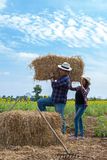 Farmers man and women working in a field Stock Image