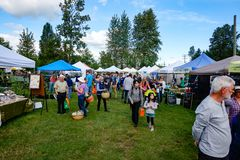 Farmers Market in Courtenay, British Columbia Canada. Shoppers enjoying the day at the local Farmers Market in Courtenay on Vancouver Island, British Columbia royalty free stock photos
