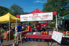 Michigan Farmers Market. The Country Mill apple stand at the East Lansing Farmers Market in Michigan Royalty Free Stock Photo