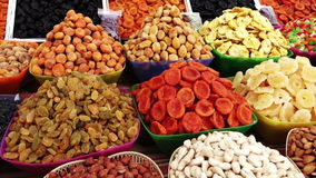 Farmers market goods. Assortment of dried fruits and nuts at a farmers market in Pyatigorsk, Russia stock video footage