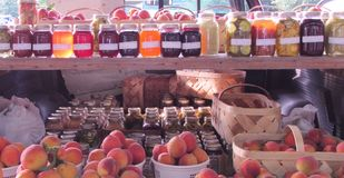 Farmers Market- Homemade Jams ,Jellies and Fresh Picked  Peaches Stock Images