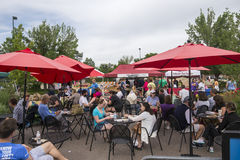 Farmers Market. Patrons sit down to enjoy some of the freshly prepared food available at the Cherry Creek Farmers Market in Denver, Colorado Royalty Free Stock Image