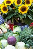 Farmers market stall Provence France vegetables and sunflowers. Farmers market Provence France vegetables and sunflowers Stock Image