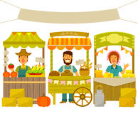 Farmers market. Farmers selling their products on wooden stalls Stock Images