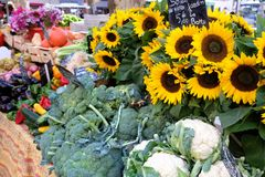 Farmers market stall provence France vegetables sunflow. Farmers market stall provence France with vegetables and sunflowers Royalty Free Stock Image