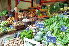 Farmers market stall with root and green vegetables Royalty Free Stock Photography