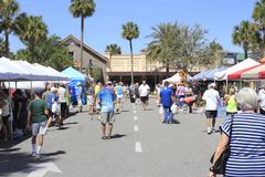 Farmers Market in Sunny Paddock Square. The Villages, FL, USA -April 1, 2017: Farmer's market near Paddock Square. People shop from various Farmer's Market stock images