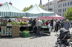 Farmers market Sweden. A local farmers market in Malmo Sweden, fruits and vegetables are sold under tents where people are looking for the best deal royalty free stock photography