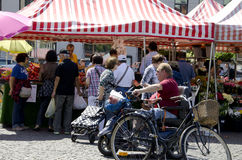 Farmers market Sweden. A local farmers market in Malmo Sweden, fruits and vegetables are sold under tents where people are looking for the best deal royalty free stock photos