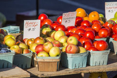 Farmers Market Table 3. Variety of fruit and vegetables in baskets aranged on tables at a farmers market Stock Photos
