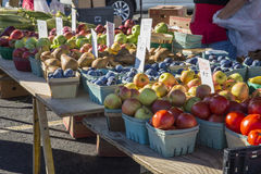 Farmers Market Table 1. Variety of fruit and vegetables in baskets aranged on tables at a farmers market Royalty Free Stock Photos