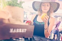 Farmers Market. Young woman shopping at the local Farmers market royalty free stock photos
