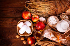 Farmers natural organic products on wooden background. Royalty Free Stock Photos