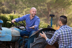 Farmers near agricultural machinery Royalty Free Stock Photos