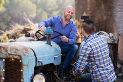 Farmers near agricultural machinery Stock Image