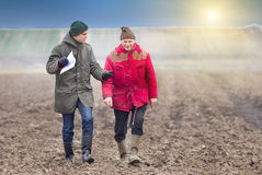 Farmers on plowed field Stock Images