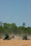 Farmers plowing the field Royalty Free Stock Photography
