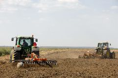 Farmers plowing with tractor royalty free stock photography