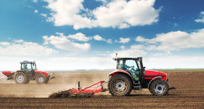 Farmers preparing land and fertilizing. Stock Images