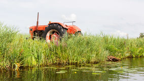 Farmers pumping water with old tractor Royalty Free Stock Photography