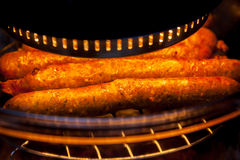 Farmers sausages in the oven Royalty Free Stock Photos