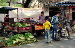 Pengzhou, China: People at Tian Fu Market. Farmers selling farm-fresh produce from the back of their motorcycle trucks to passerby at the Tian Fu outdoor market Royalty Free Stock Photography