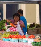 Farmers selling their fruits and vegetables at the farmer`s market in this small New Jersey town on this date stock images