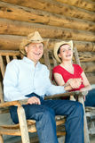 Farmers Sitting Outside Cabin Laughing - vertical Stock Photos