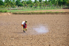 Farmers are spraying herbicide in field before planting Royalty Free Stock Images