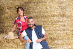 Farmers. Stood to piles of hay Stock Images