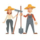 Farmers in straw hats and with work equipment Royalty Free Stock Photo