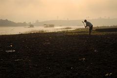 Farmers are tilling to planting in the morning. Royalty Free Stock Image