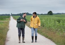 Farmers walking on country road Stock Images