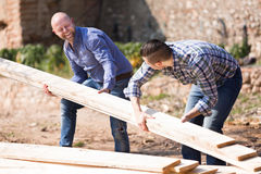 Farmers working with construction materials Royalty Free Stock Photography