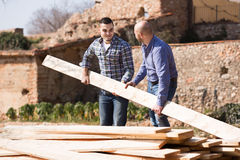 Farmers working with construction materials Royalty Free Stock Image