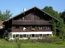Farmhouse. Traditional farmhouse in Bavaria with a colorful garden Stock Images
