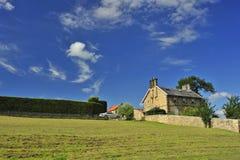 Farmhouse. A stone farmhouse on a hillside, under a summer sky Royalty Free Stock Photo