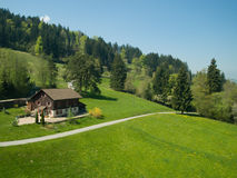 Farmhouse in alpine meadow Royalty Free Stock Image