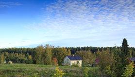 Farmhouse in autumn. A view across an open field to a country farmhouse on a clear autumn day in Lempaala, Finland Stock Photos