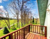 Farmhouse balcony view. Early spring Royalty Free Stock Photography
