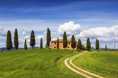 Farmhouse with cypresses around, Tuscany Stock Photo