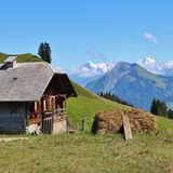 Farmhouse and distant view of Mount Eiger. royalty free stock image