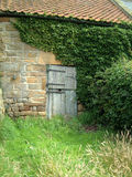 Farmhouse door. Old farm door, set in a stone wall of an old barn, Yorkshire Royalty Free Stock Photos