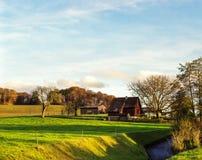 Farmhouse in the fall stock photo