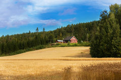 Farmhouse on field Royalty Free Stock Photography