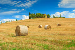Farmhouse and hay bale in Tuscany,Italy,Europe Royalty Free Stock Photography