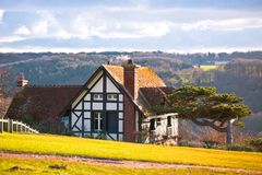 Farmhouse on a hill Stock Photo