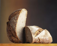 Farmhouse loaf cut in two Royalty Free Stock Photos