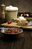 Farmhouse meal. Farmhouse produce on rustic table Royalty Free Stock Photography